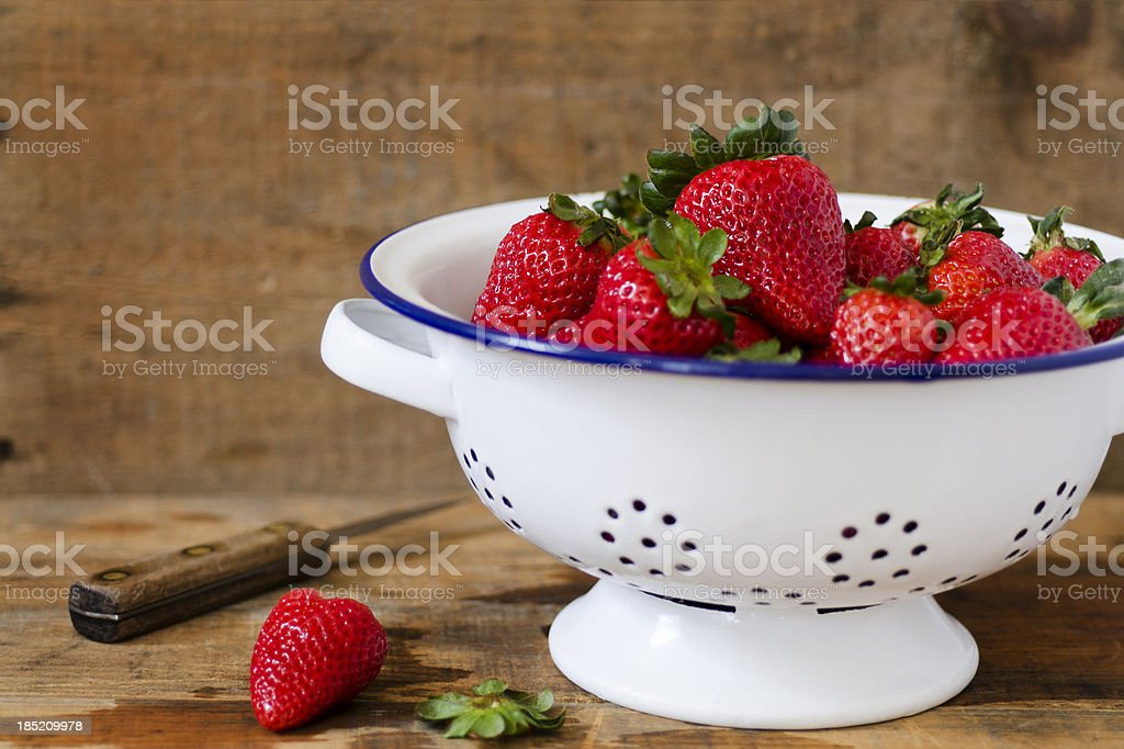 Freshly Washed Strawberries in an Antique Colander with Copy Space stock photo