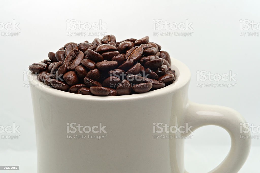 Freshly-Roasted Coffee Beans In A White Mug royalty-free stock photo