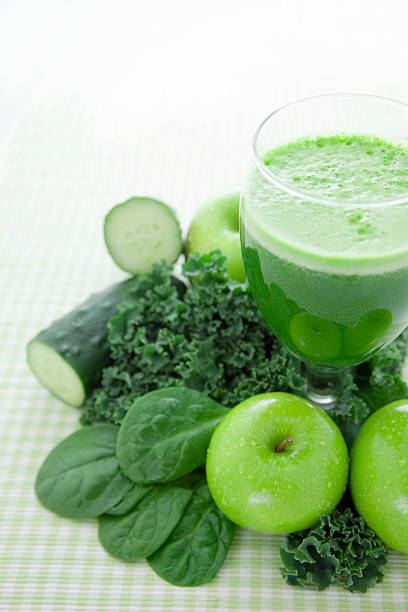 Freshly-squeezed green juice of healthy vegetables and fruit stock photo