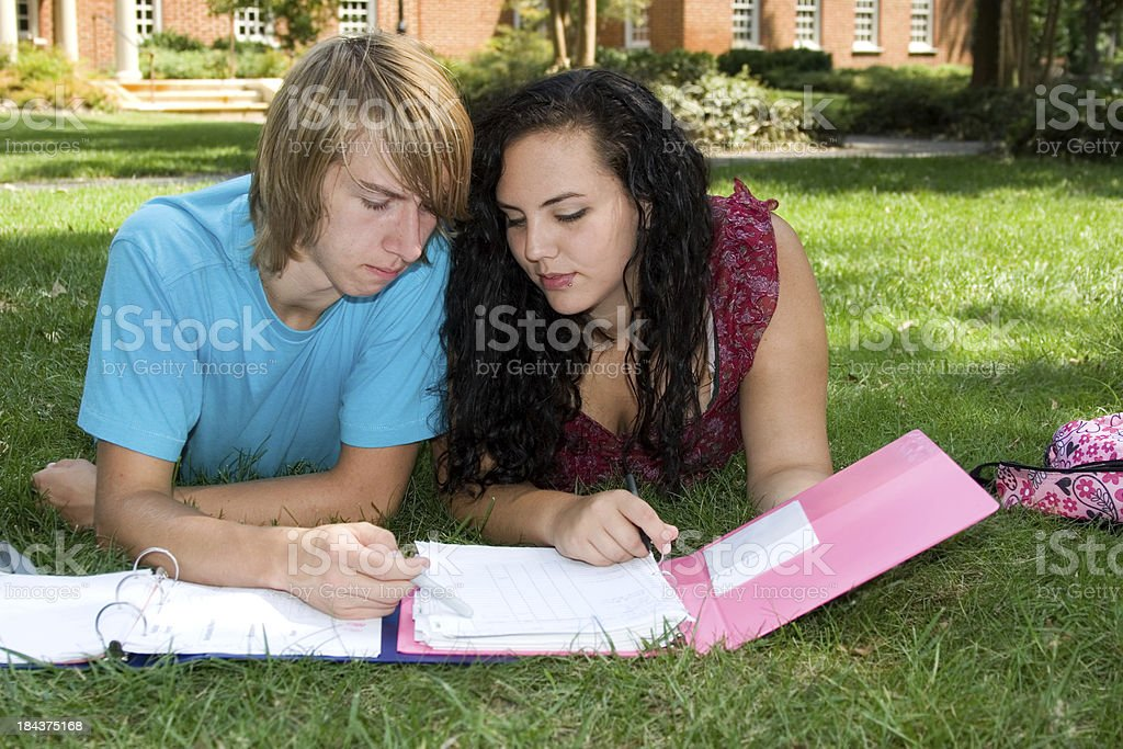 Freshman students studying outdoors on campus stock photo