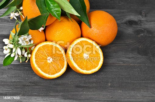 Freshness Oranges and Blossoms on Wooden Background