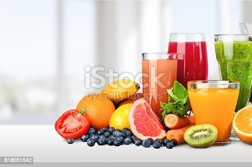 Various glasses of juice and fruits