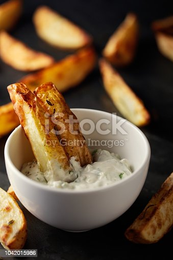Home made freshness roasted potatoes wedges with blue cheese mayonnaise dip