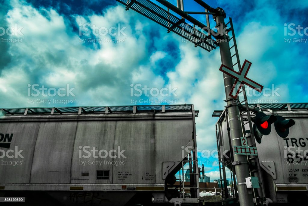 Fret train passing at a railroad crossing. stock photo