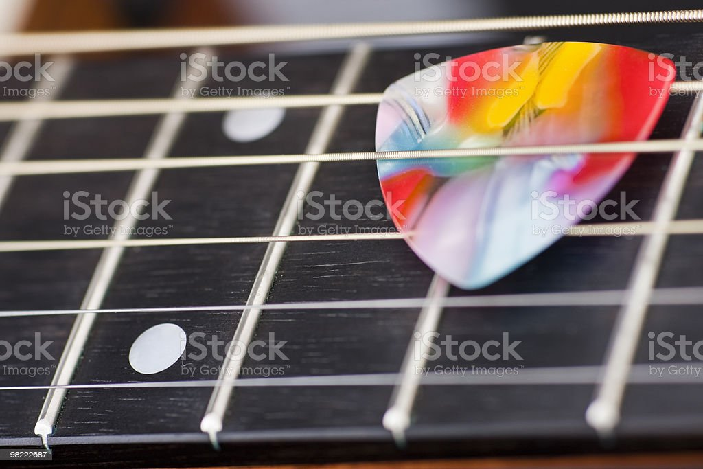 Fretboard and Multi coloured pick royalty-free stock photo