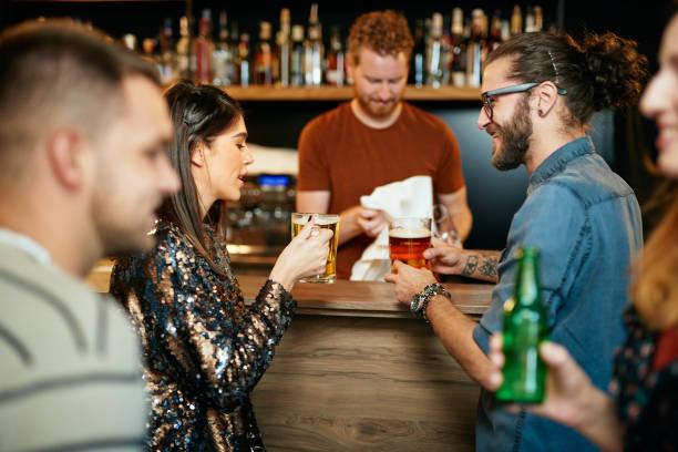 Freunds having fun at pub. stock photo