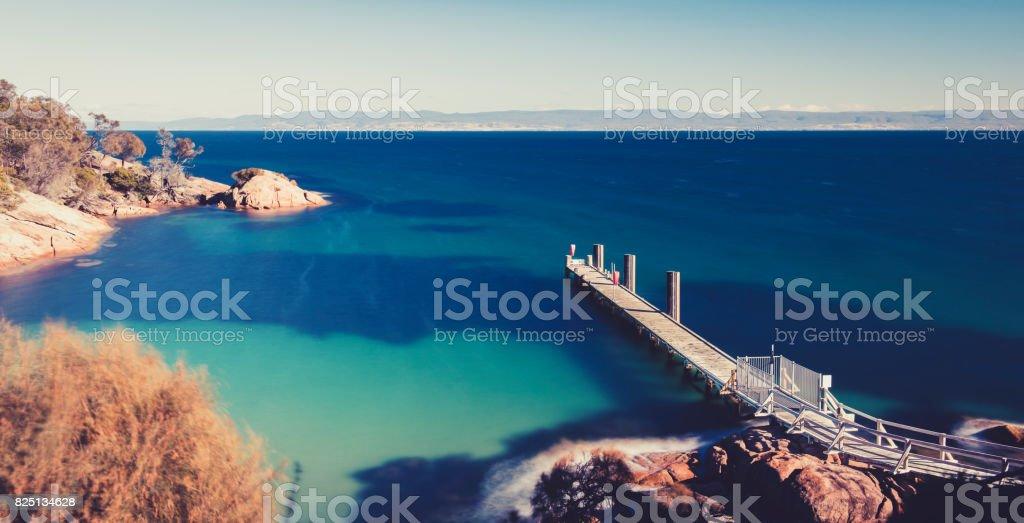 Freycinet Pier by Coles Bay in Tasmania stock photo