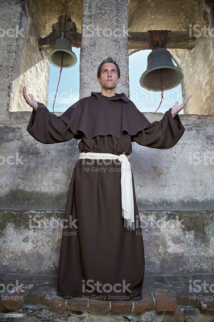 Friar and bells stock photo