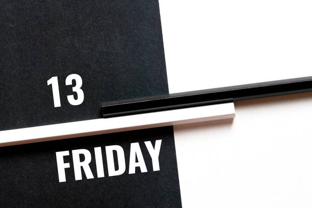 friday 13, monochrome concept with paper sheets and pencils stock photo