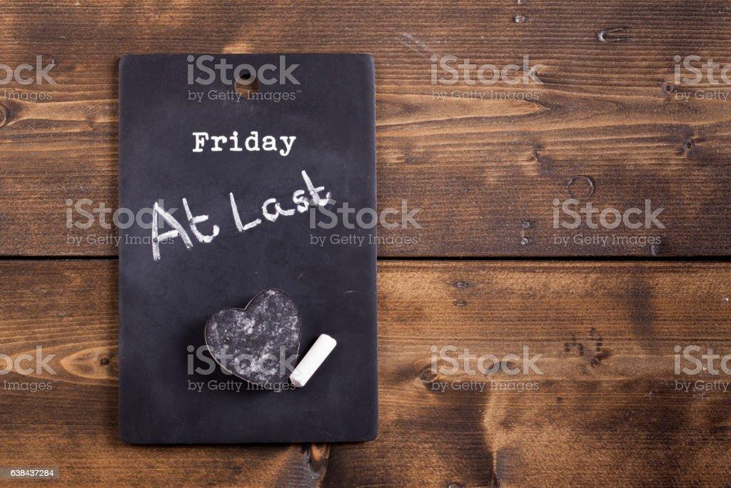 Friday at last blackboard notice stock photo