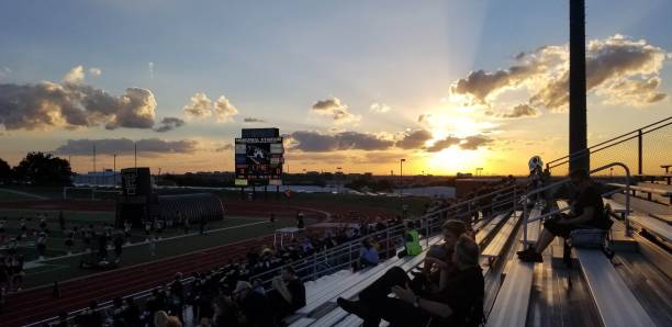 Friday Night Lights Sunset over high school football in Texas high school sports stock pictures, royalty-free photos & images