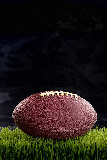 Friday Night Lights. Friday night lights with football and room for your type. american football league stock pictures, royalty-free photos & images