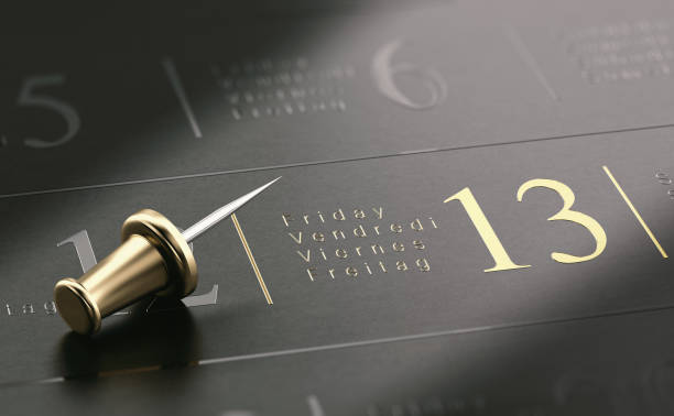 Friday The 13th Written In Golden Letters Over Black Background stock photo