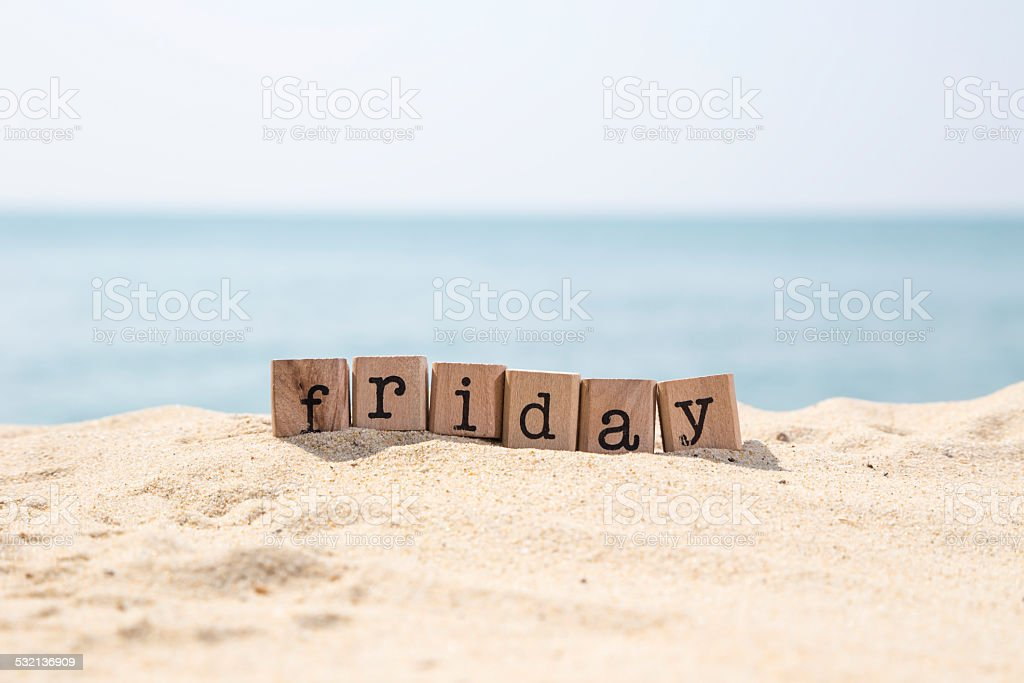 Friday word on sea sand beach stock photo