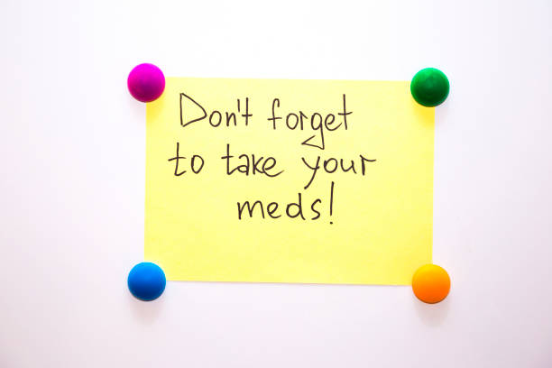 fridge note with the reminder: don't forget to take your meds! - prescription meds stock pictures, royalty-free photos & images