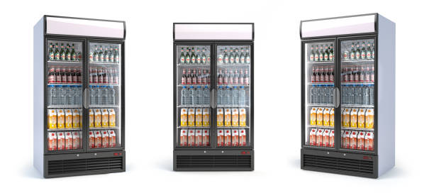 Fridge with drinks isolated on white. Set of showcase refrigerators with water, beer nad soda in the grocery shop. stock photo