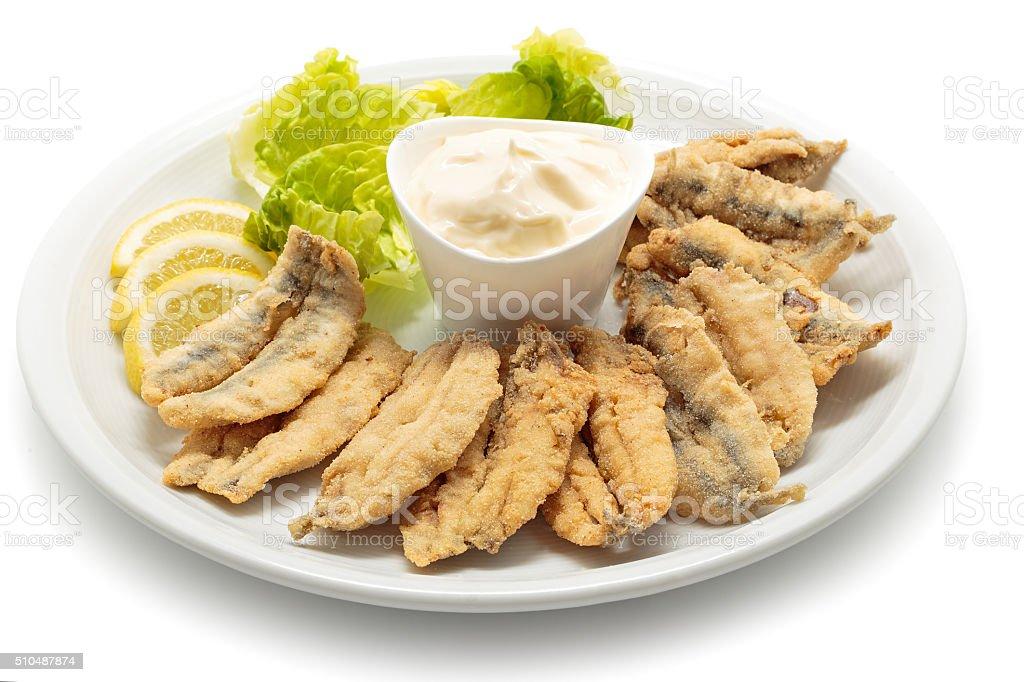 Frito com salada e maionese de anchovas foto royalty-free