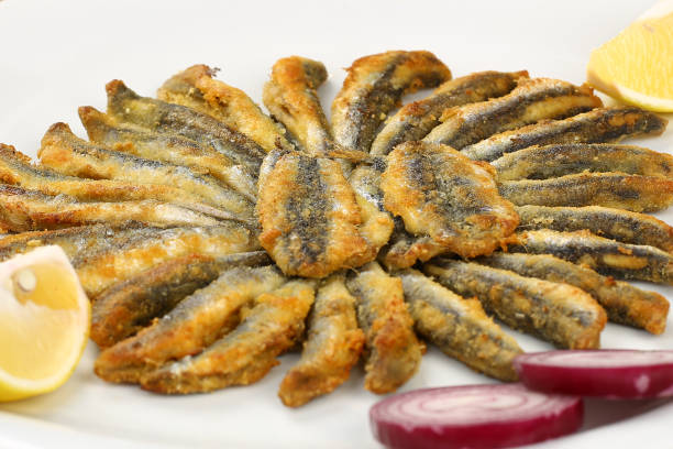 Fried Anchovy Anchovy, Fish, Sardine, Cast Iron, Food taken on mobile device stock pictures, royalty-free photos & images