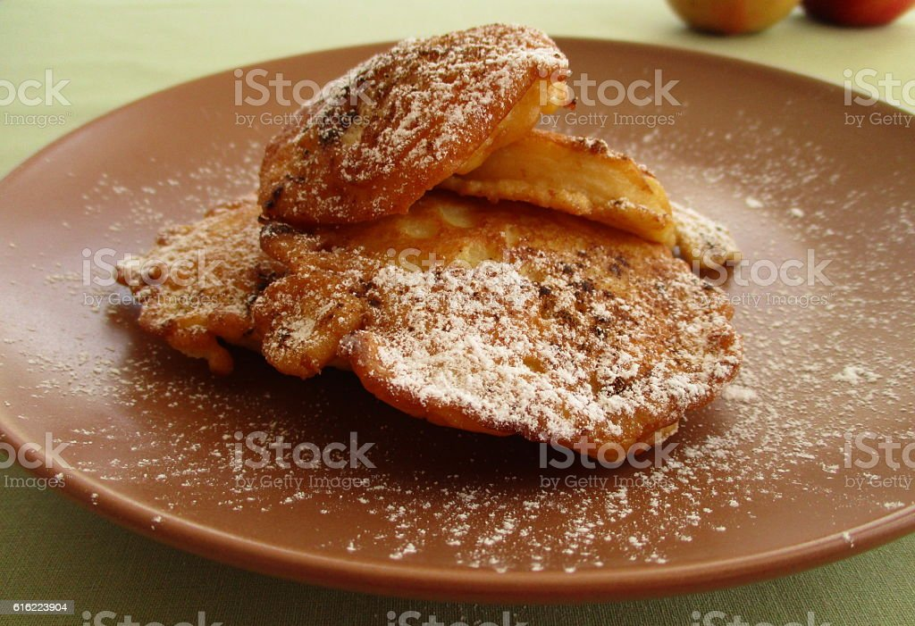 Fried apples on brown plate stock photo