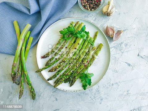 fried asparagus on gray concrete background