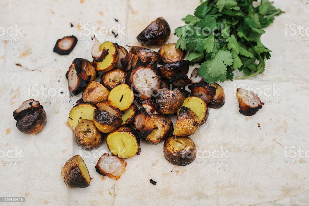 Fried bacon and potatoes with herbs lies in the pita. royalty-free stock photo