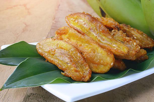 fried bananas fritter with sesame seed - foto de acervo