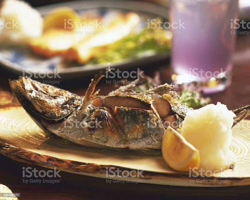 fried bass on wood royalty-free stock photo