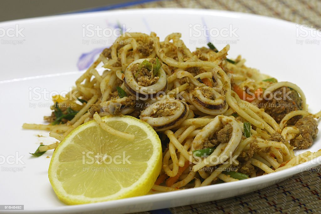 Fried beef and seafood Spaghetti stock photo