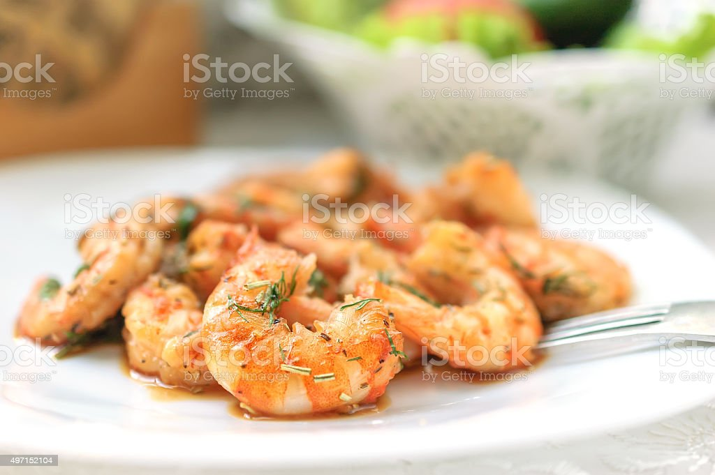 Fried black tiger prawns with herbs and spices. stock photo