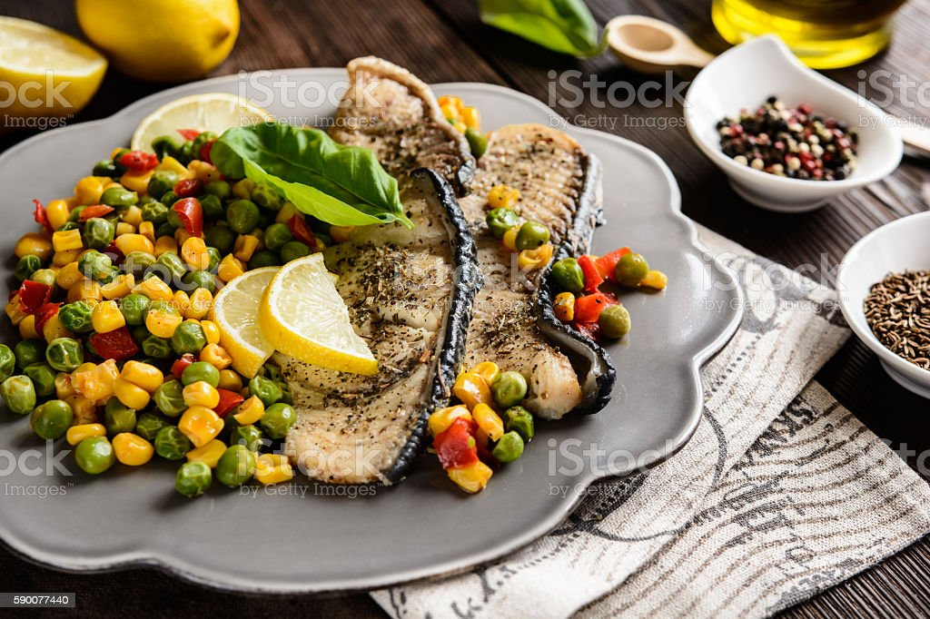 Fried blue shark with steamed vegetable stock photo