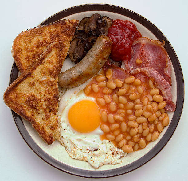 Fried Breakfast Small full English fried breakfast. full stock pictures, royalty-free photos & images
