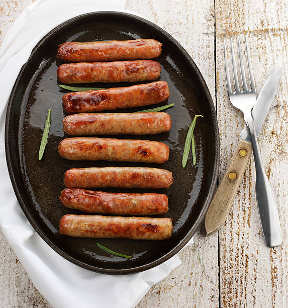 fried breakfast sausage links - sausage stock photos and pictures