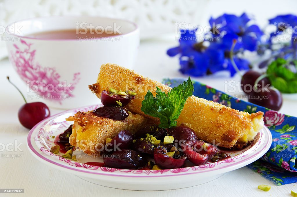 Fried brie with Cherry Sauce. stock photo