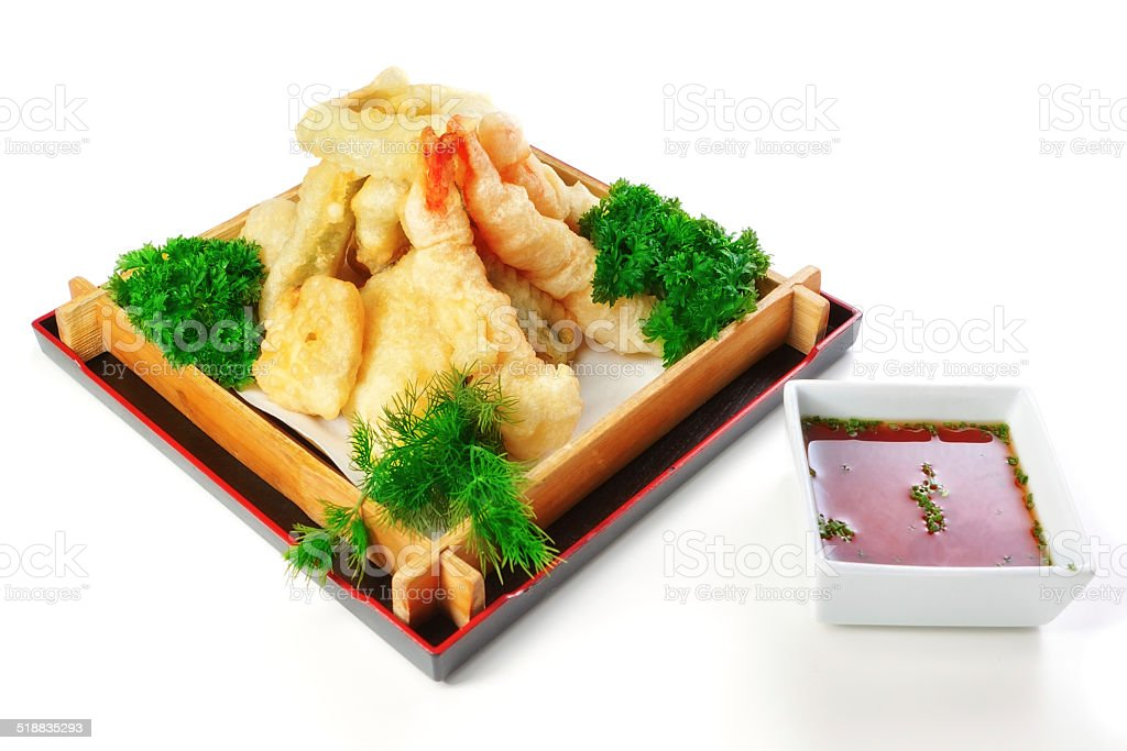 Fried calamari with parsley and dill in a decorative wooden stock photo