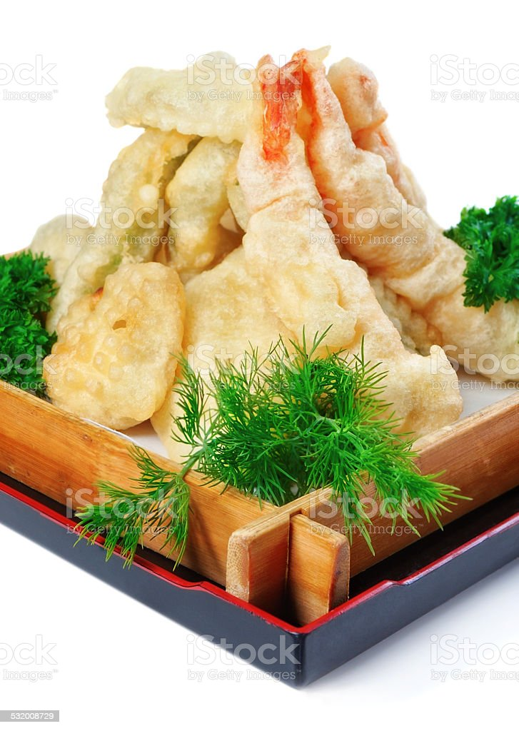 Fried calamari with parsley and dill in a wooden plate. stock photo