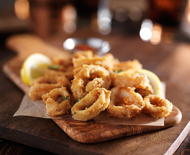 fried calimari rings on wooden tray with dipping sauce - calamares bildbanksfoton och bilder