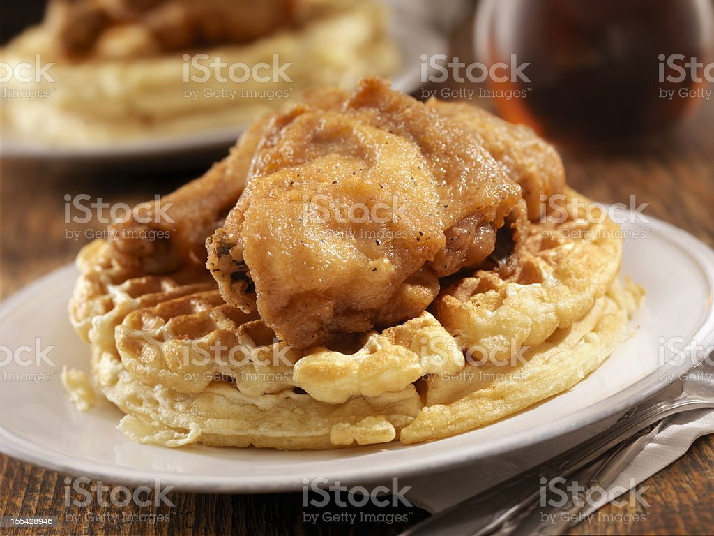 Fried Chicken and Waffles Fried Chicken and Waffles with Syrup is Classic Southern Comfort food -Photographed on Hasselblad H3D2-39mb Camera American Culture Stock Photo