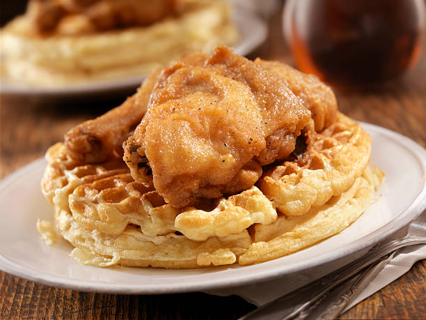 Fried Chicken and Waffles Fried Chicken and Waffles with Syrup is Classic Southern Comfort food -Photographed on Hasselblad H3D2-39mb Camera waffle stock pictures, royalty-free photos & images