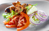 istock fried chicken breast piece fillet with vegetables salad on white plate 1095603696