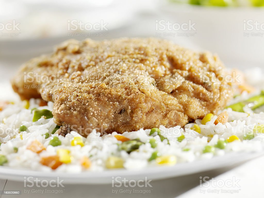 Fried Chicken Breast with Rice and Vegetables royalty-free stock photo