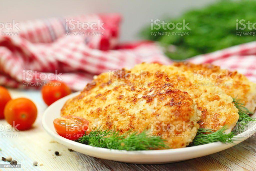 Fried chicken fillet in bread crumb stock photo