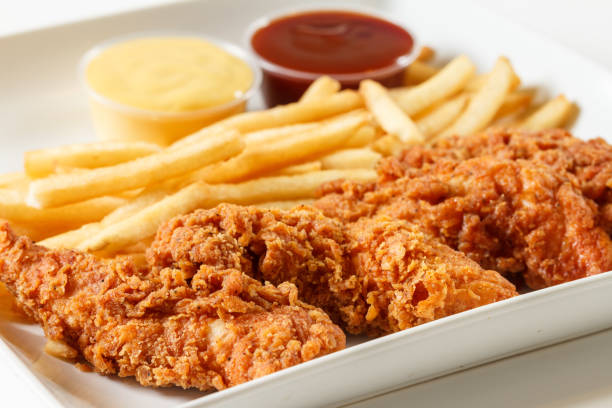 fried chicken fingers - finger stock photos and pictures