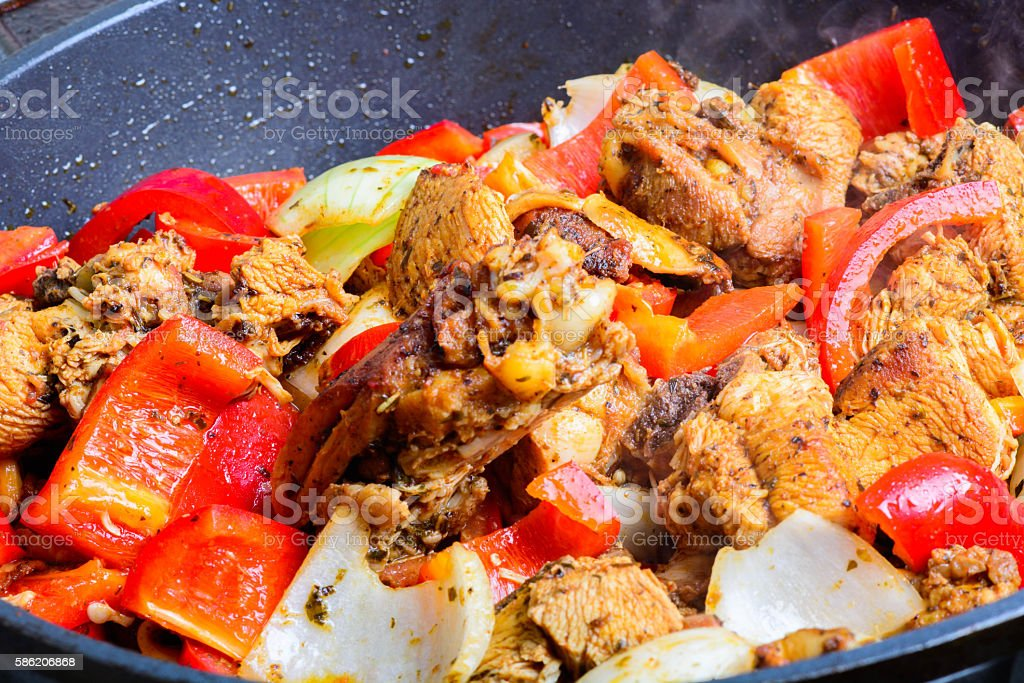 Fried chicken in the pan stock photo