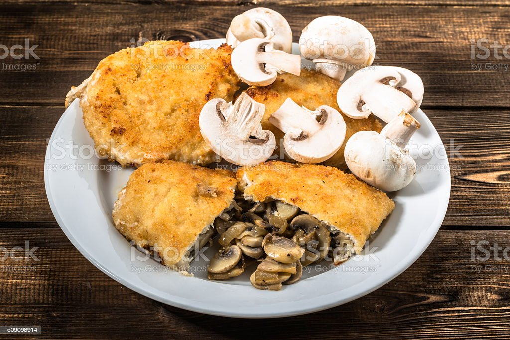 Fried chicken kiev from chicken breast stuffed with champignons. stock photo