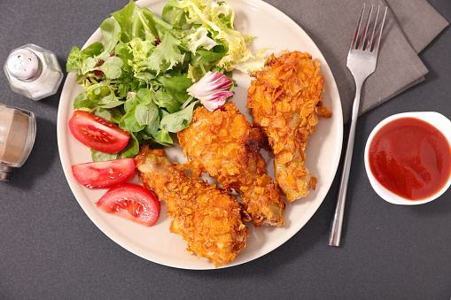 Fried Chicken Leg And Salad Stock Photo - Download Image Now