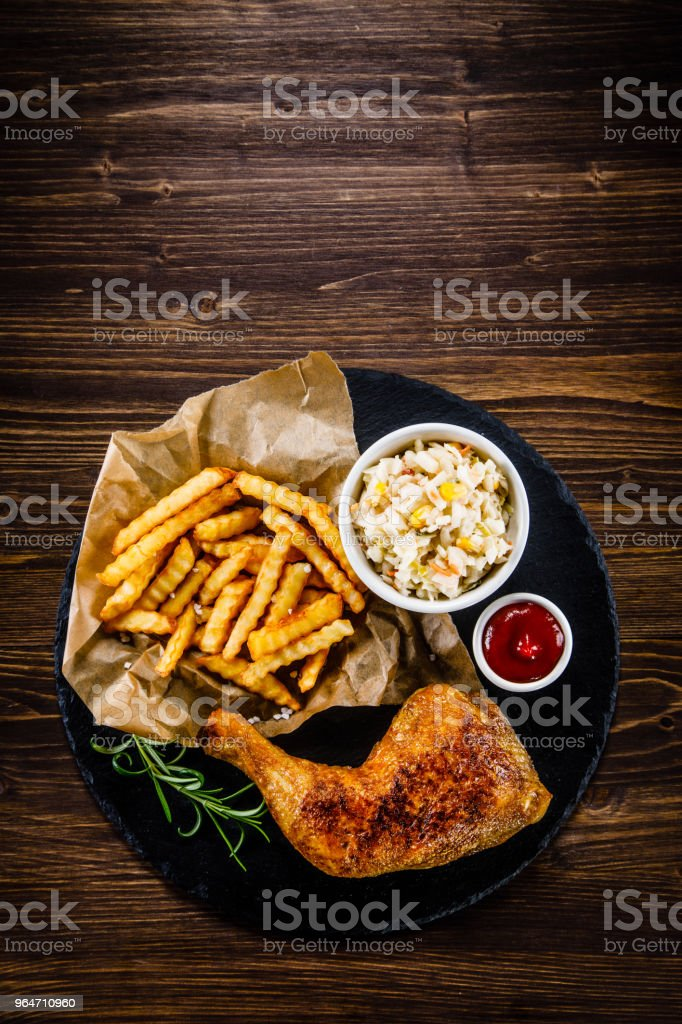 Fried chicken leg with French fries royalty-free stock photo