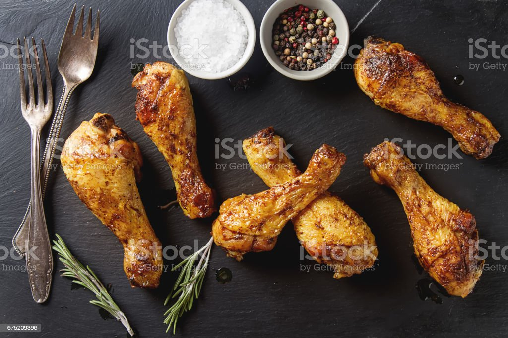 Fried chicken legs. Cooking for Christmas. Dark background. royalty-free stock photo