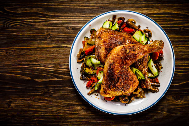 Fried chicken legs with vegetables Fried chicken legs with vegetables drumstick stock pictures, royalty-free photos & images