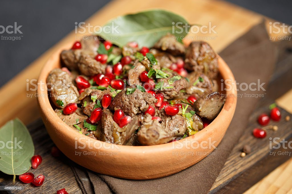 Fried Chicken Liver on wooden cutting board stock photo