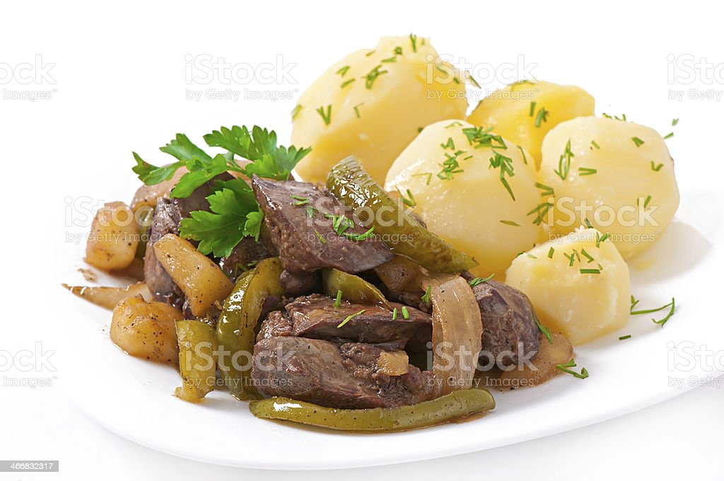 Fried chicken liver with apples, sweet pepper and onions stock photo
